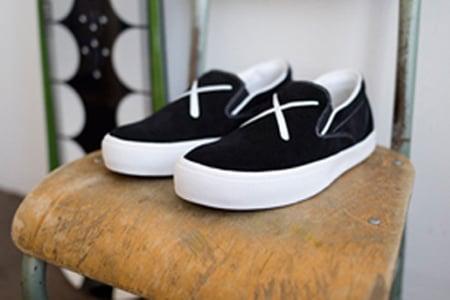http://www.sneakerfiles.com/wp-content/uploads/2007/01/visvim-kaws-slip-ons.jpg
