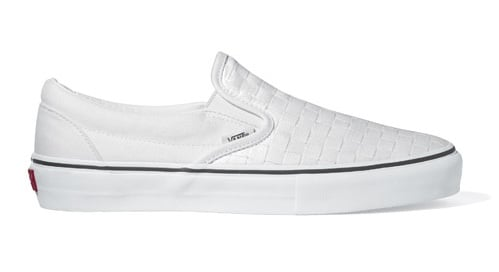 white checkerboard vans slip on