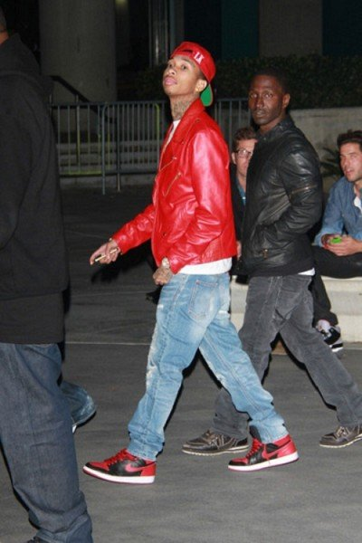 Celebrity Sneaker Watch: Tyga Rocks Banned Air Jordan Retro 1's to Watch The Throne Tour LA