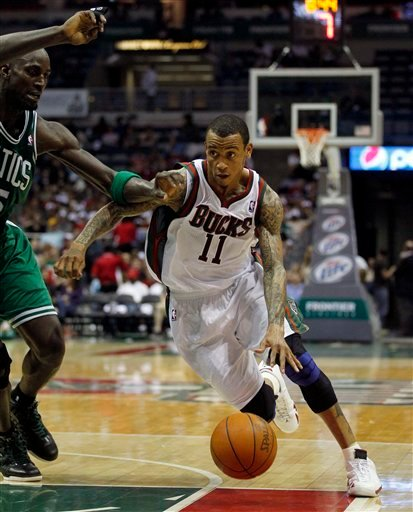 Monta-Ellis-wears-White-Red-Air-Jordan-XIV-(14)-Retro-in-Milwaukee-Debut-4
