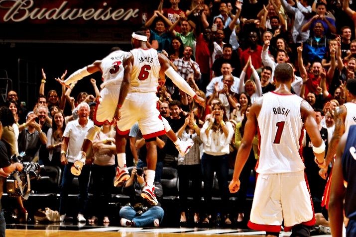 Dwyane Wade Dons 'White/Varsity Red-Black' Air Jordan XIV in OT Win