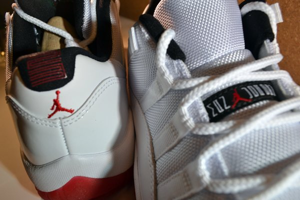 Air Jordan 11 Low White/Varsity Red-Black at Millennium Shoes