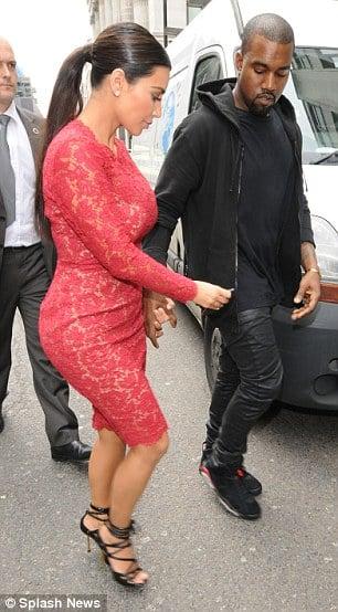 Kanye in the 'Infrared' Air Jordan 6 Alongside Kim Kardashian