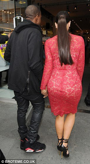 Kanye in the 'Infrared' Air Jordan 6 Alongside Kim Kardashian