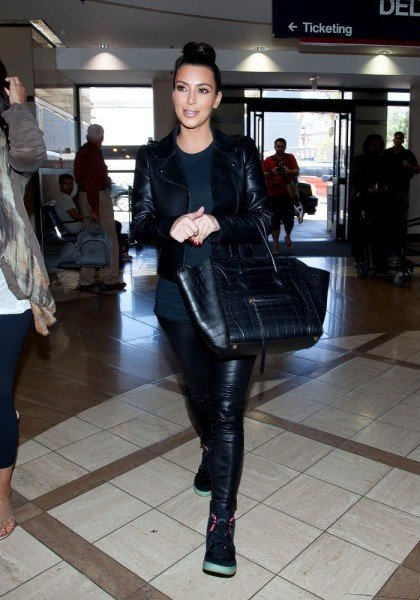 4e115c91f07f7 Kim Kardashian Heads to the Airport in the Nike Air Yeezy 2 ...