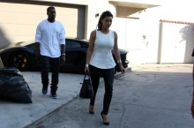 Kanye West in the Air Jordan 1 'Black/Royal' Alongside Kim Kardashian