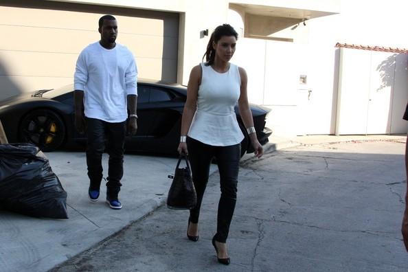Kanye West in the Air Jordan 1 'Black/Royal' Alongside Kim Kardashian