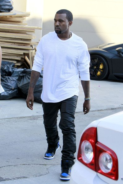kanye west in the air jordan 1 blackroyal alongside kim