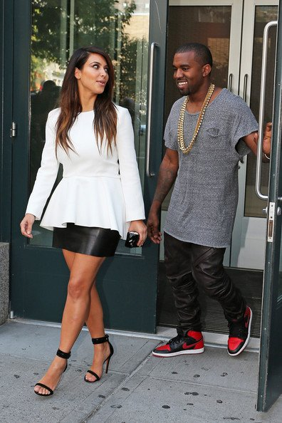Kanye West in the Air Jordan 1 'Black/Red' Alongside Kim Kardashian