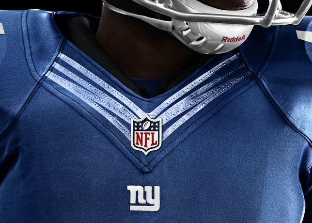 """Tonight the NY Giants and Dallas Cowboys will take the field for the NFL season opener wearing Nike's next-generation NFL uniforms. The NFL Nike Elite 51 Uniform is the most innovative NFL uniform to ever hit the field, delivering superior lightweight performance in a fully integrated system of dress for athletes at the highest level. This uniquely engineered chassis and baselayer combination provides everything an athlete needs and nothing he doesn't need. Rooted in body-led design, the uniform system is built for a body-contoured fit resulting in zero distractions in order to help amplify speed.  In addition to the new fabrication, teams chose varying levels of design changes reflecting their unique heritage. Both the Giants and the Cowboys have chosen to keep their traditional design aesthetic; however, the Giants stepped into both the new jersey and pant fabrication while the Cowboys have chosen to wear the new jersey threads and keep their former pant fabrication. They've also consolidated several colors of blue in the uniform to one distinct hue.  As a player, Nike's co-founder Bill Bowerman wore the number 51, and after serving in the 10th Mountain Division in WWII he understood the importance of a uniform in battle. Lightweight mattered, as did movement and strength. As a coach, Bowerman knew that extra ounces added up and less weight meant increased mobility and speed.  What Bowerman started, Nike continues to perfect, crafting a fully integrated system of dress where the athlete's baselayer works in concert with his entire uniform – true innovation from the inside out. Lightweight padding is integrated directly into the crucial """"hit zones"""" in the baselayer. New innovations include integrating Flywire technology into the neckline to reduce weight and provide lockdown fit over pads, increasing sleeve articulation for better range of motion, and integrating new four-way stretch fabrication to provide a streamlined shrink-wrap fit. A design that enables speed """