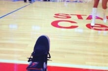 Celebrity Sneaker Watch: Wale Sits Courtside in Air Jordan 4 'Bred'