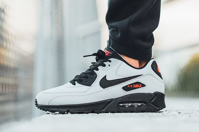 https://www.sneakerfiles.com/wp-content/uploads/2015/10/nike-air-max-90-essential-grey-black-red.jpg
