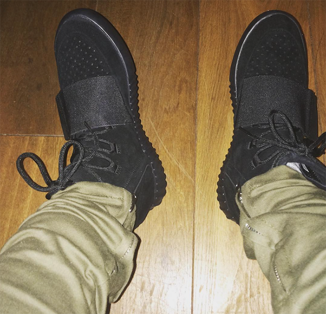 Black adidas Yeezy 750 Boost On Feet