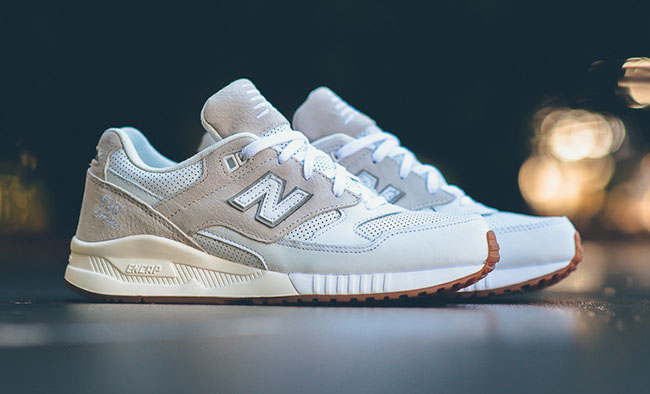 new balance 530 grey trainers with gum sole