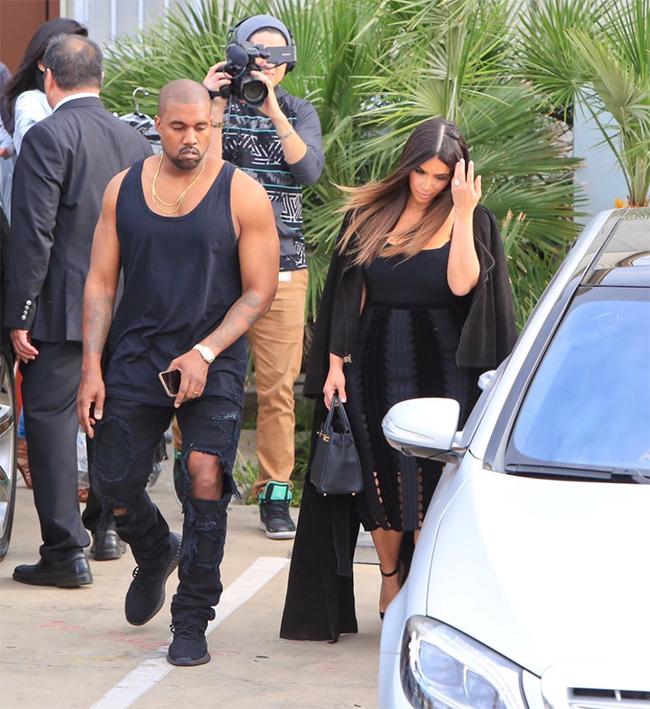 Kanye West Spotted in a New Black adidas Yeezy Boost chic ... b6bfb9294