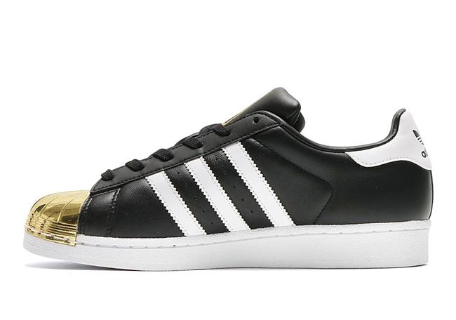 adidas superstar black gold toe