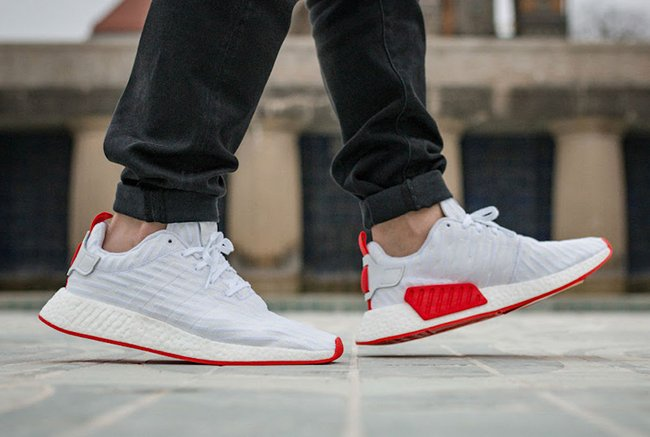 https://www.sneakerfiles.com/wp-content/uploads/2017/03/adidas-nmd-r2-primeknit-white-core-red-on-feet-2.jpg
