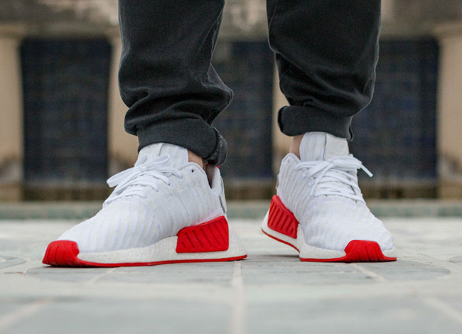 632dcba9fd169 adidas NMD R2 Primeknit White Core Red On Feet