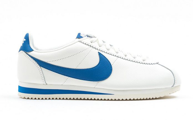 navy blue and white nike cortez