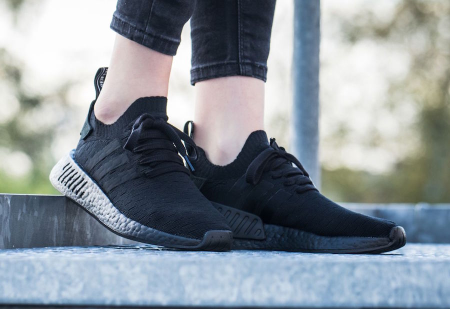 sale retailer 023ea 95a0a adidas NMD R2 Primeknit Triple Black On Feet