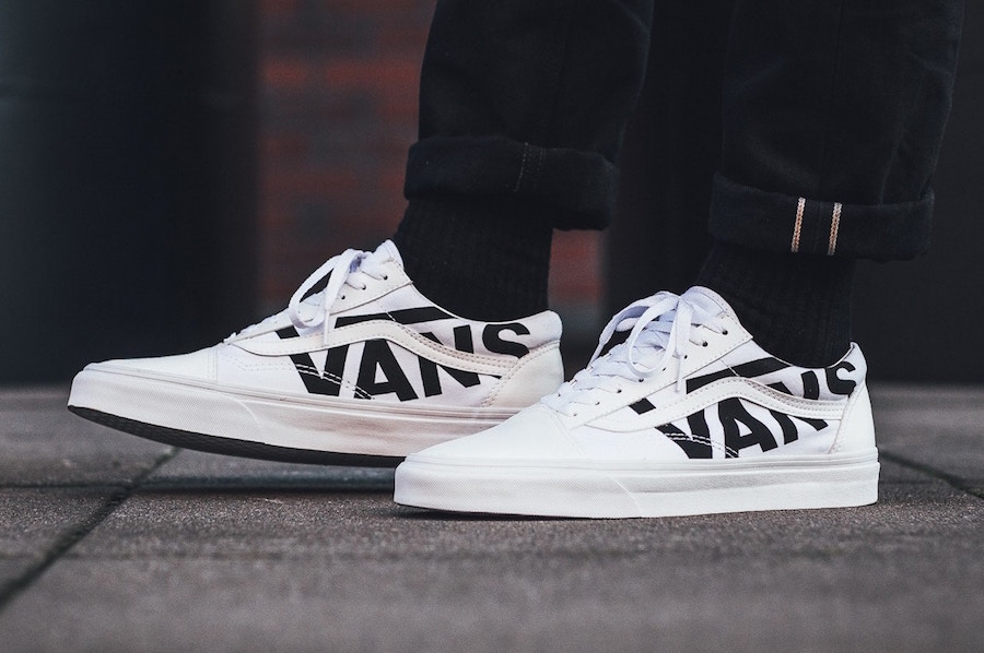 vans old skool triple white on feet