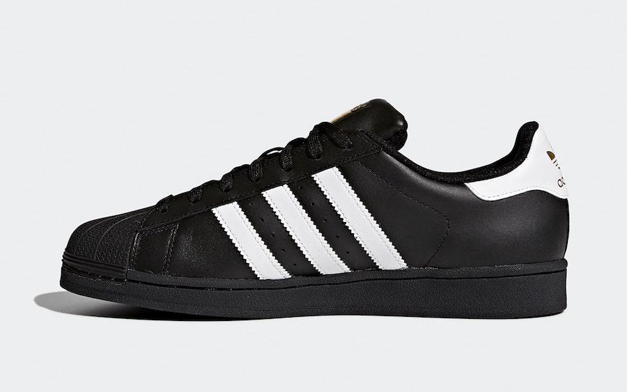 adidas superstar gold black white
